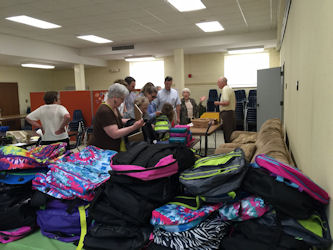 Preparing Backpacks for Arcola.